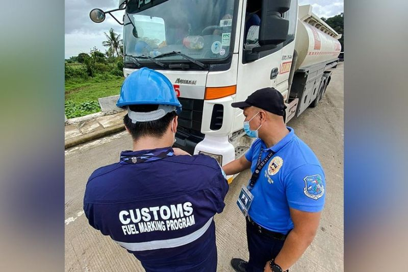 FUEL MARKING. Officers of the Bureau of Customs in Limay and Mariveles marked 10.6 billion liters of kerosene, diesel and gasoline as part of the agency's Fuel Marking Program. (Contributed photo)